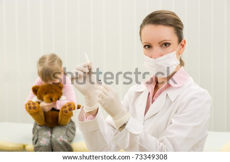 Woman nurse prepare to vaccination child in clinic