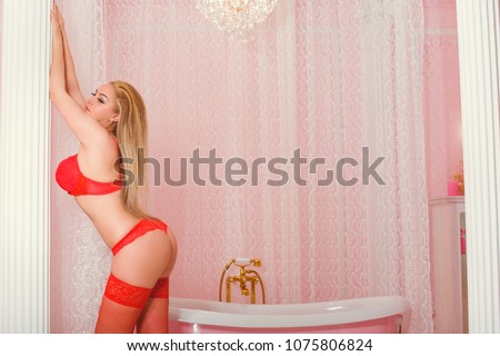 Woman of easy virtue in  boudoir. Sexy woman in half naked dress in erocic pose. Prostitution and escort concept