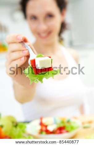 Woman offer fresh salad. Focus on food.