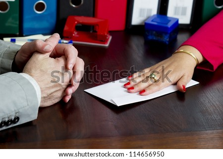 Woman offering a bribe in the envelope