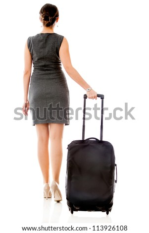 Woman on a business travel carrying her bag - isolated over a white background