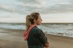 Woman on a gloomy beach