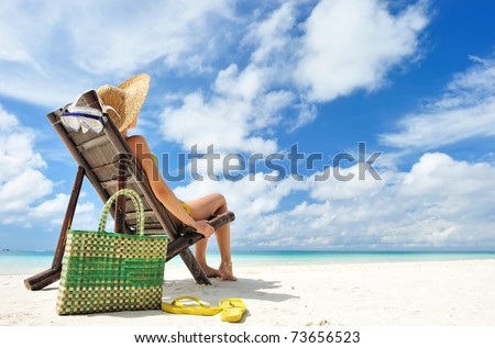 stock photo : Woman on a tropical beach with hat