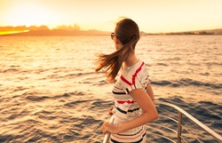 Woman on a yacht enjoying the beautiful sunset.
