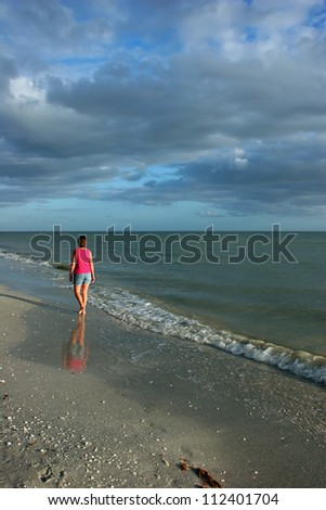 Woman On Beach at Dusk Sanibel Island Florida #112401704