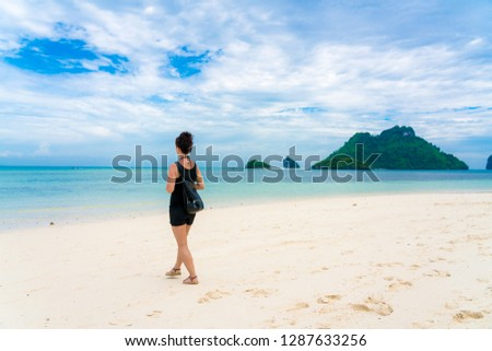 Woman on Beautiful Tropical Beach PP Island, Krabi, Phuket, Thailand blue ocean background girl items vacation accessories for holiday or long weekend a guide  choice idea for planning travel