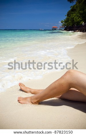Woman on beautiful tropical beach with bright sand