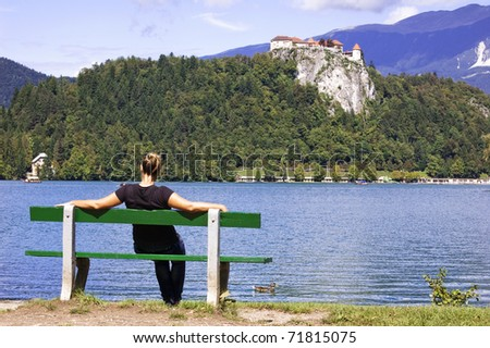 Woman on Bench in Bled (Slovenia) enjoys a beautiful summer day
