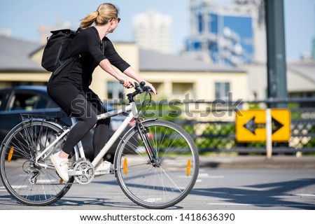 Woman on bicycle and cycling rides are great tools for improving the health of the muscles of the hip belt reducing weight and improving female libido improving psychological stability in lifestyle