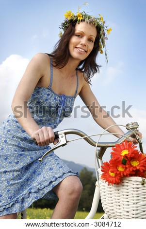 woman on bicycle on a summers day