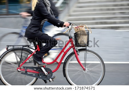 Woman on bike in profile