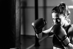 Woman on boxing training . Black and white