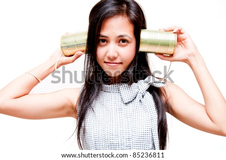 woman on call with tin can phone - stock photo