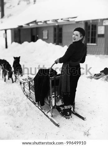 Woman on dogsled