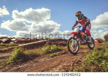 woman on enduro motocross in motion, desire for victory, dynamics of speed. #1192482412
