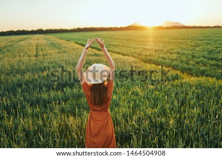 Woman on field sunset Freedom landscape in countryside countryside lifestyle