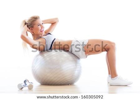 Stock Photo Woman on fitness ball