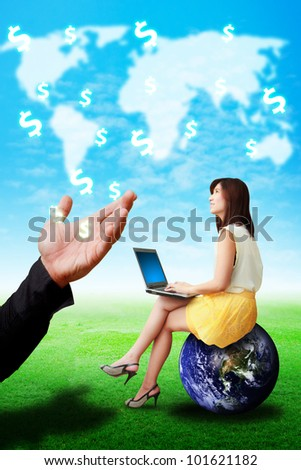 Woman on globe look at the money icon from the Hand : Elements of this image furnished by NASA
