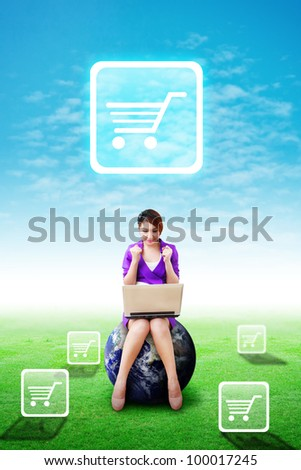 Woman on globe present the Cart icon on the blue sky and grass field : Elements of this image furnished by NASA