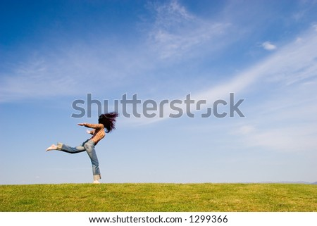 Woman on green field
