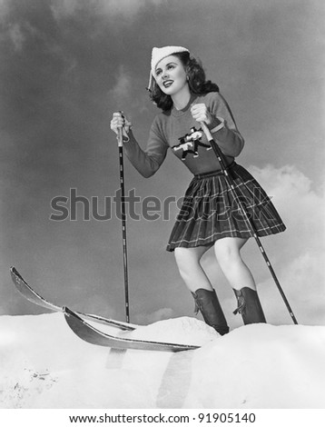 Woman on skis with knees bent