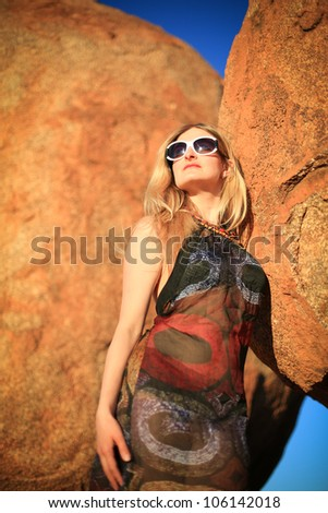 Woman on the background of rock, Devils Marbles,Northern Territory,  Australia