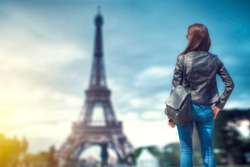 woman on the background of the eiffel tower