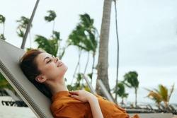 woman on the beach lounger tropics palms tan summer lifestyle