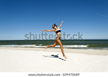 Woman on the beach with joy on her face