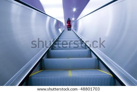 stock-photo-woman-on-the-escalator-48801703.jpg
