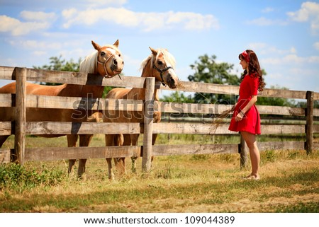 woman on the farm with her horse