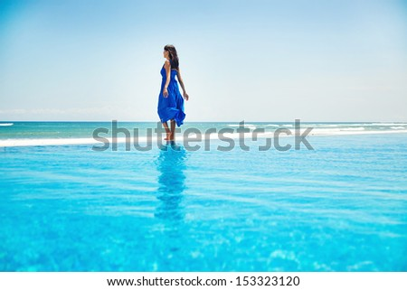 woman on the infinite water - freedom concept