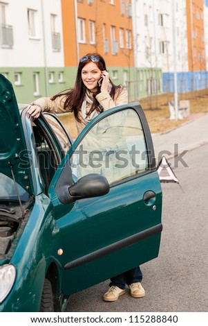 Woman on the phone for car help breakdown accident problem - stock photo