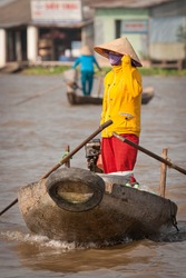 Woman on the traditional vietnamese boat, Mekong Delta, Vietnam