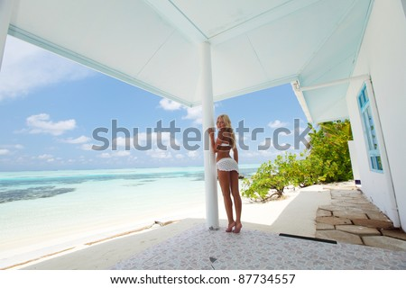 woman on the veranda of the tropical house