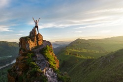 Woman on top mountain in Altai, sunset light, beauty summer landcape