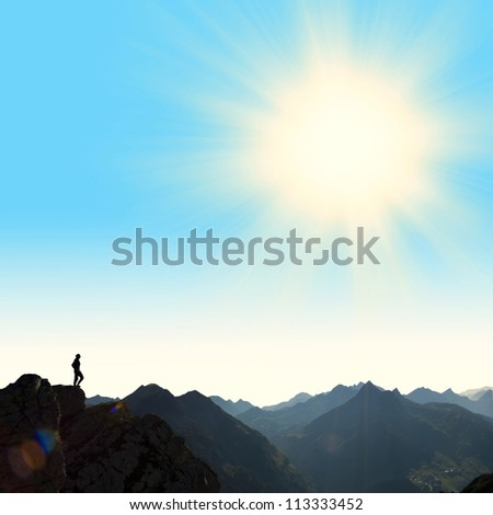 woman on top of high mountain