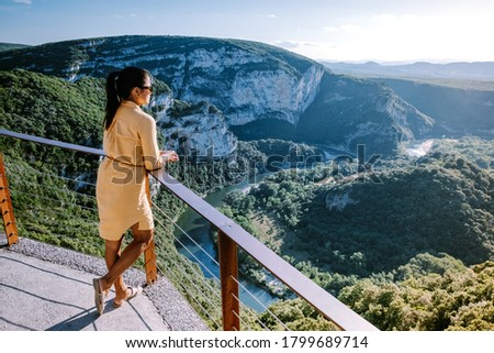 woman on vacation in the Ardeche France Pont d Arc, Ardeche France,view of Narural arch in Vallon Pont D'arc in Ardeche canyon in France Europe