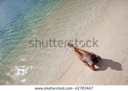 Woman on white sand beach - stock photo