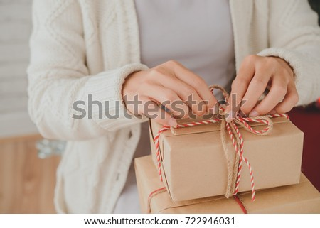 Woman opening presents on Christmas morning #722946031