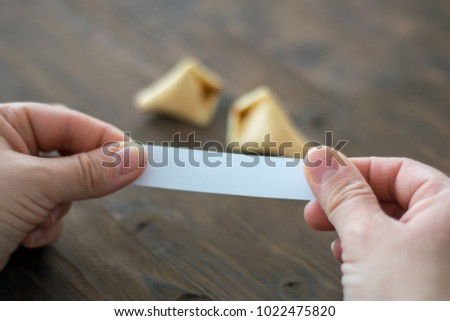 Woman opens a fortune cookie