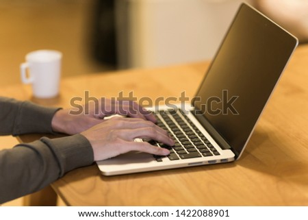 Woman operating a personal computer #1422088901