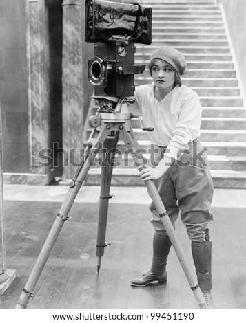 woman operating movie camera