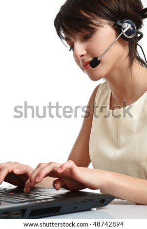 woman operator with headset (microphone and headphones) working - using a notebook