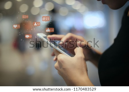 woman or Lady using mobile smart phone at night