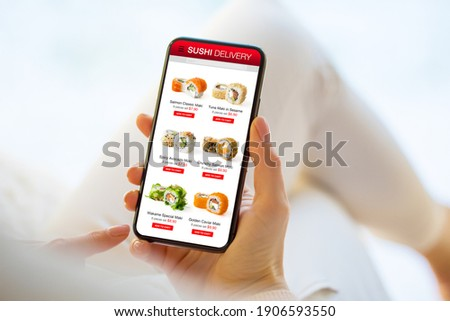 Woman ordering sushi online for home delivery Stok fotoğraf ©