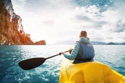 Woman paddles kayak on the lake of General Carrera, Patagonia, Chile