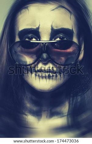 Stock Photo Woman painted as a skeleton with glasses