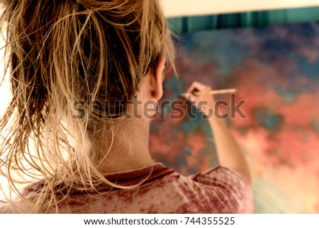 Woman painting #744355525