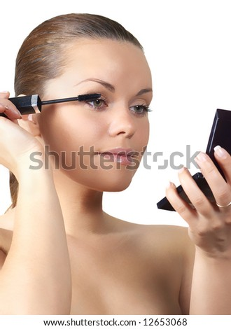 Woman painting eyelash (isolated on white)